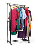 Mobile rack with clothes on white background Stock Images