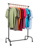 Mobile rack with clothes on white background. Royalty Free Stock Photo