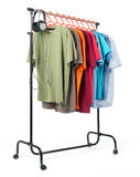 Mobile rack with clothes on white background. Royalty Free Stock Photography