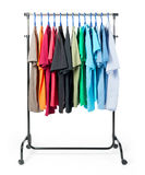 Mobile rack with clothes on white background. Stock Images