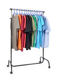 Mobile rack with clothes on white background Stock Photos