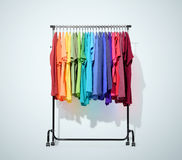 Mobile rack with color clothes on light blue background. File contains a path to isolation Royalty Free Stock Images