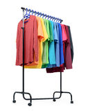 Mobile rack with color clothes on white background. File contains a path to isolation. Stock Image