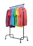 Mobile rack with color clothes on white background. File contains a path to isolation. Royalty Free Stock Image