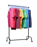 Mobile rack with color clothes on white background. File contains a path to isolation. Stock Photos