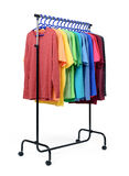 Mobile rack with color clothes on white background. File contains a path to isolation. Royalty Free Stock Photography