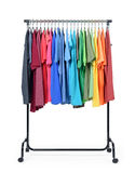 Mobile rack with color clothes on white background. File contains a path to isolation. Stock Photo