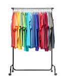 Mobile rack with color clothes on white background. File contains a path to isolation. Stock Images