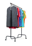 Mobile rack with color clothes on white background. File contains a path to isolation. Stock Photography