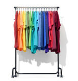 Mobile rack with color clothes on white background. File contains a path to isolation.  Royalty Free Stock Photos