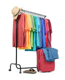 Mobile rack with colorful clothes and a suitcase on white background. File contains a path to isolation Stock Photos