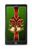 Mobile with red Christmas bow Stock Image