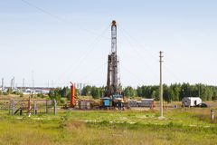 Mobile rig at work drilling. Mobile drilling rig for natural gas Stock Image