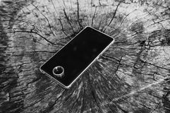 Mobile and ring are placed on wooden floor. Mobile and ring are on wooden floor stock photography