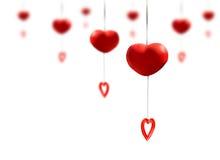 Mobile rouge de coeur fait à partir de l'argile en céramique accrochant sur le backgro blanc Photographie stock libre de droits