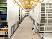 Mobile shelves in a modern storehouse stock image