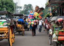 Malioboro street Jogyakarta Indonesia. Lady carrying her street shop home in Jogyakarta Indonesia Stock Image