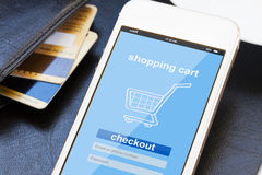 Mobile shopping concept. Virtual shop on phone screen with credit cards Stock Photos