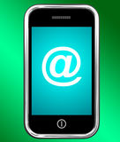 Mobile With At Sign For Emailing Or Contacting Stock Photos