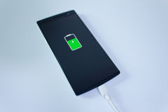 Mobile smart phone battery charge Royalty Free Stock Images