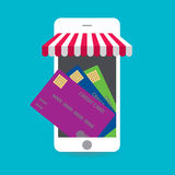 Mobile smart phone with bunch of credit card on a screen. Electronic payments concept. Royalty Free Stock Photo