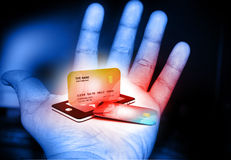 Mobile smart phone with credit card. In human hand Stock Image