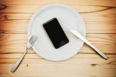Mobile smart phone served as dinner on white plate Stock Photo