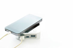 Mobile smart phone smartphone charging with power bank on white background Stock Images