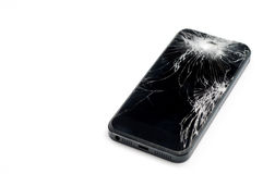Mobile smartphone with broken screen isolated on white background with stock image