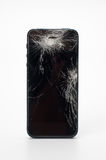 Mobile smartphone with broken screen isolated on white background with royalty free stock image