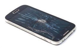 Mobile smartphone with broken screen isolated on white background. crack screen royalty free stock photography