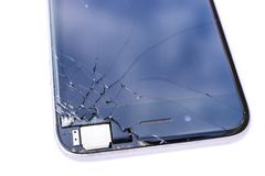Mobile smartphone with broken screen. Isolated on white background royalty free stock photo