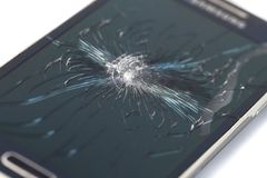 Mobile smartphone with broken screen on white backgroun royalty free stock photos