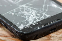 Mobile smartphone with broken screen Royalty Free Stock Photo