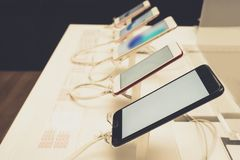 Mobile smartphone in store royalty free stock image