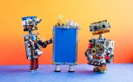 Mobile smartphone gadget and robots. Funny robotic toy characters, creative design touch screen phone device, light bulb. Capacitors sim card. Blank blue stock photography