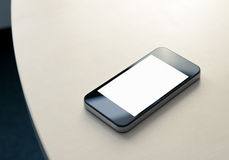 Mobile Smartphone On The Table. Mobile smartphone lying on the office table with blank screen royalty free stock photography