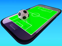 Mobile soccer game. Smart phone mobile telephone with soccer football game Stock Image