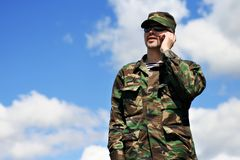 Soldier Mobile Phone, Military Man Camouflage Army Uniform calling. Soldier with Mobile Phone, Military Man in Camouflage Army Uniform calling by cellular phone Stock Image