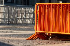 Mobile steel fence. orange street barriers to restrict movement before the concert. Orange street barriers to restrict movement before the concert. mobile royalty free stock images