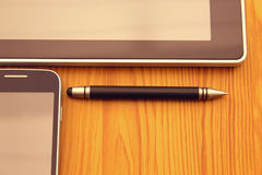 Mobile, stylus and tablet Stock Photography