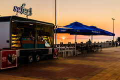 Mobile Summer Restaurant. A mobile summer cafe restaurant during a wonderful, calm and peaceful sunset located in Cinarcik town of the country Turkey - offers Stock Images