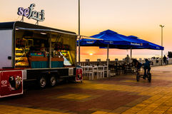 Mobile Summer Restaurant. A mobile summer cafe restaurant during a wonderful, calm and peaceful sunset located in Cinarcik town of the country Turkey - offers Royalty Free Stock Photo