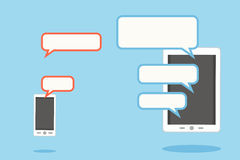 Mobile and tablet with speech bubbles Stock Photography
