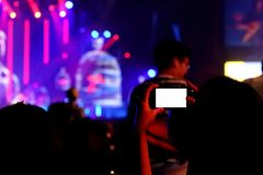 Mobile Take Photo in Concert Show. Take Photo in Concert Show Hall Dancing near Stage Pongsit Concert musical famous in Thailand Bangkok stock photography