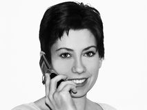 Mobile talk. Female talking on a mobile phone Stock Photography
