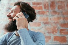 Mobile technology digital device man talk phone. Mobile technology and digital device addiction. smiling man talking on the phone royalty free stock photography