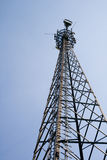 Telecommunication tower with blue sky background Royalty Free Stock Images