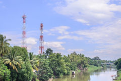 Mobile telephone antenna near river Stock Images