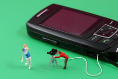 Mobile Telephone entertainment. Making graphic contents for mobile phones Stock Image